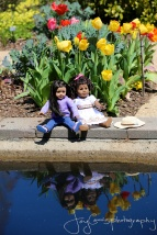 Dolls by the reflecting pool